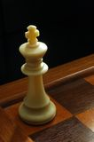 The king in problems. White chess king in corner Royalty Free Stock Photo