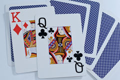 King and queen. Open playing cards - king of diamonds and queen of clubs stock photography