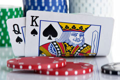 King and Queen. Pocket with chips in the background royalty free stock photos