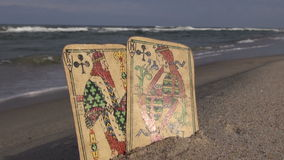 King and queen antique cards on the resort  beach stock video