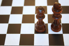 King and queen. Black chess figures - queen and king Royalty Free Stock Images