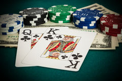 King, queen cards, dollar bills and casino chips Royalty Free Stock Photos