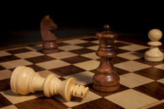 Checkmate on chessboard - black background Royalty Free Stock Photography