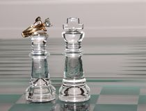King and Queen And Diamonds. King and Queen chess pieces. The Queen wears a diamond and gold wedding band set royalty free stock image