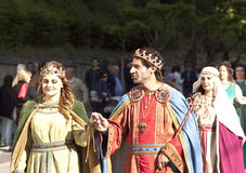 King and Queen. Enna, Italy - May 2016: Boy and girl dressed as a King and Queen takes part in the medieval costume parade along the street. Tenth Edition of stock image