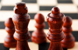 The King and Queen in front of the pawns Stock Image