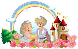 The king and queen in front of their castle Stock Images