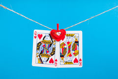 King and Queen of Hearts isolated with clothes peg rope Royalty Free Stock Photos