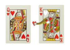 King and Queen of hearts in a relationship. King of hearts gives his heart to the queen of hearts royalty free stock photography
