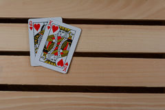 King and Queen of hearts. On wooden pallet Royalty Free Stock Images