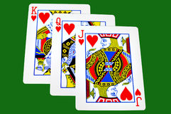 King,Queen and Jack of hearts. Isolated on green with clipping path Stock Photography
