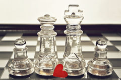 King, queen and pawns on chess board Stock Photography
