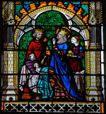 King and Queen praying for their son to heal - stained glass in. Stained glass window depicting a King and Queen praying for their ill son, in the Cathedral of Stock Images