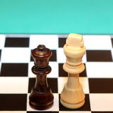 King and Queen. Two chess figures - one black, one white. King and queen royalty free stock images