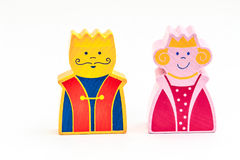 King and queen. Two wooden figures of a king and a queen isolated on white background Royalty Free Stock Photos