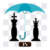 The king and the Queen under an umbrella. On the background of a chessboard Royalty Free Stock Images