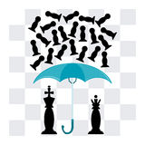 The king and the Queen under an umbrella. On the background of a chessboard. The umbrella falling pawns Stock Image