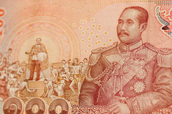 King Rama V on Thai banknote. Detail of a 100 Baht banknote from Thailand showing His Majesty King Chulalongkorn (Rama V) in navy uniform and also in a scene royalty free stock images
