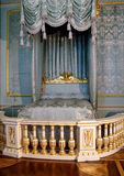 Hermitage, Saint Peterburg, Russia - JUNE 10, 2013: King bed stands in the room of Hermitage palace. King`s bed stands in the palace royalty free stock photos