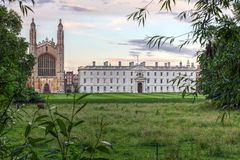 King`s College, Cambridge, England. Sunset view of the King`s College Chapel and Gibbs` Building in Cambridge, England United Kingdom from across the Cam River stock photo
