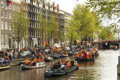 King's day in Amsterdam canals Royalty Free Stock Image