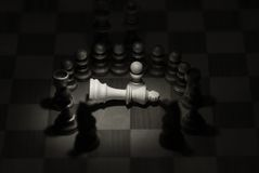The King's death 2. A pawn stay alone in front of his dead king.All other chess piece stay around in commemoration royalty free stock photo