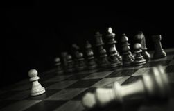 The king's death. The white king is dead.A pawn now is alone royalty free stock photos