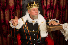 King's oath. Royal king swearing a solemn oath at his inauguration Stock Image