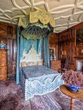 The King`s Bedroom, Burton Agnes Hall, Yorkshire, England. The King's State Bedroom has the original ceiling and oak wall panelling. The seventeenth royalty free stock image