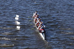King`s Wimbledon Crew races in the Head of Charles Regatta Men`s Youth Eight Royalty Free Stock Photography
