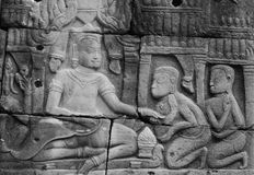 King and servants. Royal court scene of Cambodian king. Carved on a stone wall of Angkor Vat temple Royalty Free Stock Images