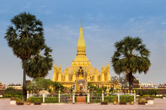 King Setthathirat statue and Pha That Luang stupa Royalty Free Stock Image