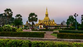 King Setthathirat statue and Pha That Luang stupa Stock Images