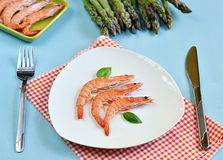 King shrimps with basil leaves in a white plate Stock Images