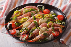 King shrimps with chilli, herbs and vegetables close-up. horizon Stock Photography