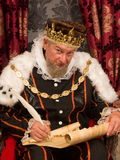 King signing parchment Stock Photo
