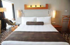 King size bed. Luxury hotel room with a king size bed stock photo