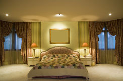 King size bed. Master bedroom with a king bed Royalty Free Stock Images