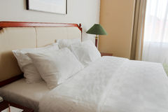 King size Bed. Photograph of luxury five star hotel king size bed stock images