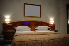 King-size bed with bedside tables Stock Photography
