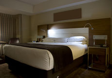 King-size bed with bedside tables lamps Royalty Free Stock Image
