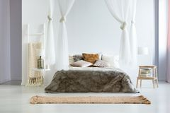 King-size bed with fur coverlet Stock Photography