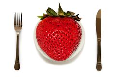 King size strawberry on plate. White backgound Stock Images