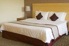 King sized bed Stock Photography