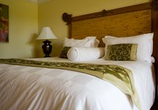 King sized bed in a hotel suite room Royalty Free Stock Image