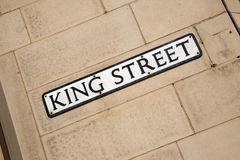 King Street Sign on Brick Wall Stock Photo