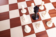 King surrounded by pawns Royalty Free Stock Photography