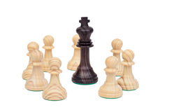 King surrounded by pawns. Royalty Free Stock Photography
