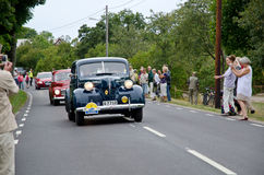 The King of Sweden drives his old timer car. On August 18:th 2012 the King and Queen of Sweden participated in an oldtimer car rally and the king was driving his Royalty Free Stock Photo