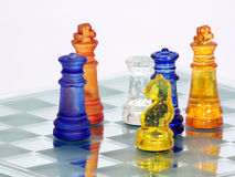 King Team ATTACK. Chess game in glass boarding playing challenge Royalty Free Stock Images